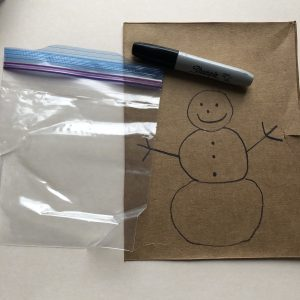 picture of snowman template on cardboard with permanent marker and resealable storage bag