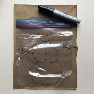 resealable storage bag over snowman template with permanent marker