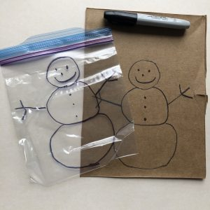 traced snowman from template onto resealable storage bag and permanent marker