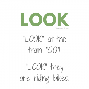 "image stating ""LOOK"", ""LOOK at the train ""GO""!, and ""LOOK"" they are riding bikes."